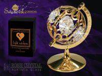 Golden globe decoration with Swarovski crystals