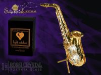 Golden saxophone decoration with Swarovski crystals