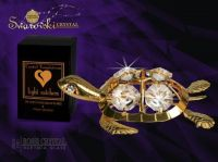 Golden turtle decoration with Swarovski crystals